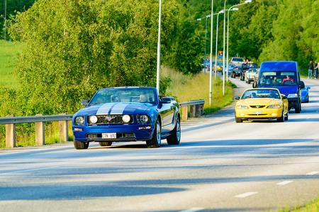 mustang gt: Ronneby, Sweden - June 26, 2015: Veteran car street cruise on public roads. Ford mustang gt blue 2006.