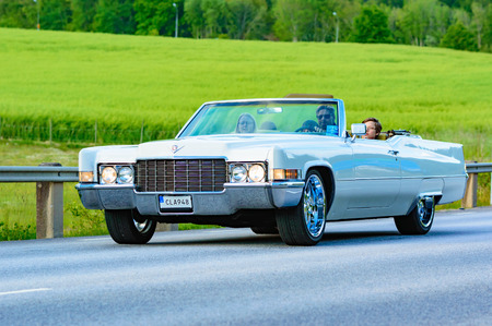 Ronneby, Sweden - June 26, 2015: Veteran car street cruise on public roads. Cadillac deville white 1969. Editorial