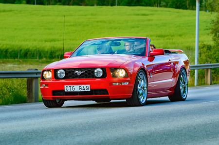 Ronneby, Sweden - June 26, 2015: Veteran car street cruise on public roads. Ford mustang 2005 red. Editorial