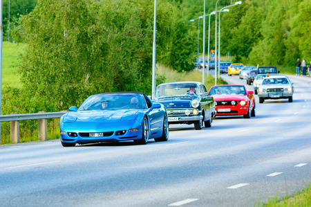 mustang gt: Ronneby, Sweden - June 26, 2015: Veteran car street cruise on public roads. Chevrolet corvette blue 1999. Editorial