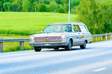 fury: Ronneby, Sweden - June 26, 2015: Veteran car street cruise on public roads. Plymouth fury II brown 1966.