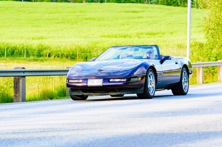 Ronneby, Sweden - June 26, 2015: Veteran car street cruise on public roads. Chevrolet corvette purple 1990.