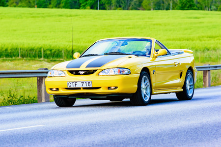 mustang gt: Ronneby, Sweden - June 26, 2015: Veteran car street cruise on public roads. Ford mustang gt 1998 yellow Editorial