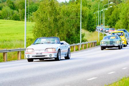 mustang gt: Ronneby, Sweden - June 26, 2015: Veteran car street cruise on public roads. Ford mustang gt white 1987.