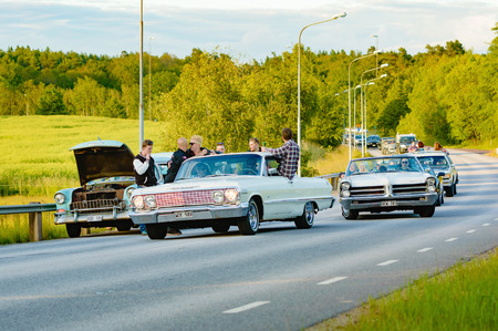turmoil: Ronneby, Sweden - June 26, 2015: Car break down and cause some chaos on the street during a road cruise for veteran cars. Drunk passengers behave unsafe and venture into street.
