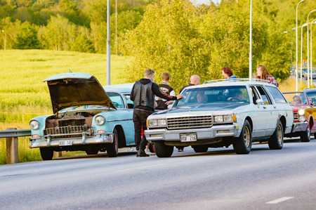 behave: Ronneby, Sweden - June 26, 2015: Car break down and cause some chaos on the street during a road cruise for veteran cars. Drunk passengers behave unsafe and venture into street.