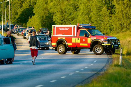 bedlam: Ronneby, Sweden - June 26, 2015: Car break down and cause some chaos on the street during a road cruise for veteran cars. Drunk passengers behave unsafe and venture into street.