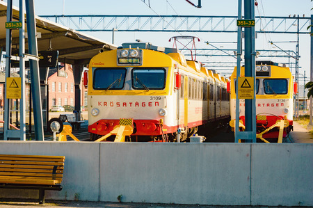 unsustainable: Karlskrona, Sweden - August 03, 2015: Delays and poor track qualities are only some of the resent problems in Swedish railway business. Here are two trains at the station one summer morning. Editorial