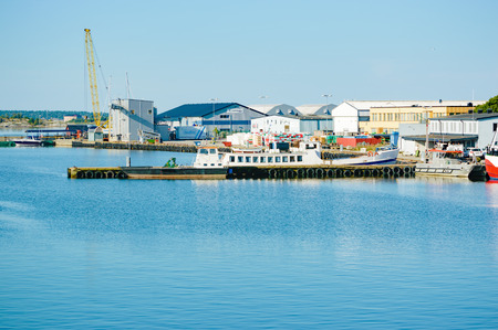 fishing industries: Karlskrona, Sweden - August 03, 2015: Fishing industry is no longer as intense as it used to be. This harbor used to be full of fishing vessels and fishing industries. This is Salto fishing harbor.