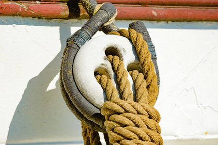 pulleys: Nautical tool for distributing the load of heavy sails ans such. Block and tacle or pulleys on the outside of a sailing ship.