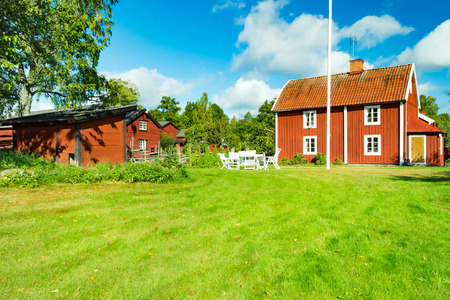 uphold: Stensjo by, Sweden - August 28, 2015: This small rural village is a heritage property. It is preserved and upheld to show how Life was in the villages in Sweden in the old days. Editorial