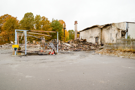 reckless: Large part of warehouse is totally destroyed by arson. Almost nothing remains after a devastating fire. Here is the rubble that is left after the fire brigade left the scene. Stock Photo