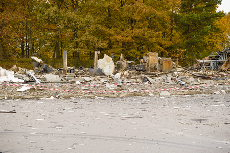 devastating: Large part of warehouse is totally destroyed by arson. Almost nothing remains after a devastating fire. Here is the rubble that is left after the fire brigade left the scene. Stock Photo