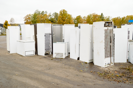 Old used refrigerators and freezers are stored separately in the waste station. Here are some standing together Stock Photo