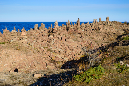 erected: Limestone towers in multitude are erected in a quarry on the island of Oland, Sweden. Tower after tower rise with the horizon in the background.