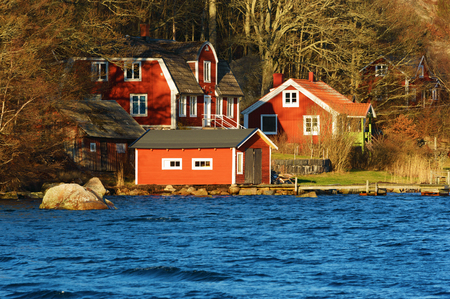 Ronneby, Sweden - December 30, 2015: Lovely red homestead close to water. A law demanding repayment on mortgages is suggested to start by may 1 2016 in Sweden. Editorial