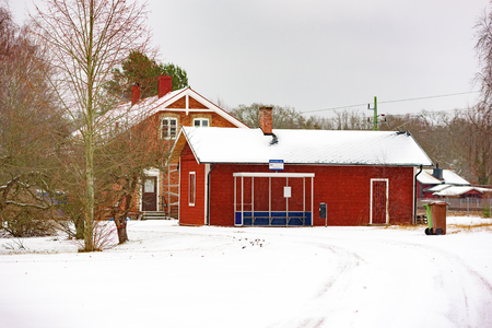 no snow: Johannishus, Sweden - January 8, 2016: The bus terminal in rural Johannishus. It is winter and snow cover the road. No person visible.