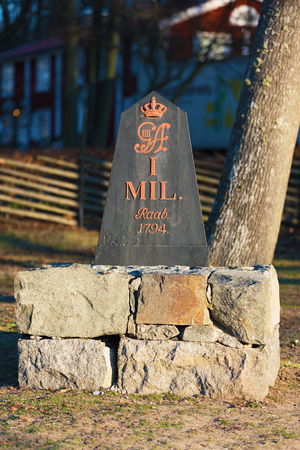 adolf: An iron mile stone from 1794 with the royal emblem of Gustav IV Adolf in old roman style where IV is written IIII. Raab was a governor. Karlskrona, Sweden.