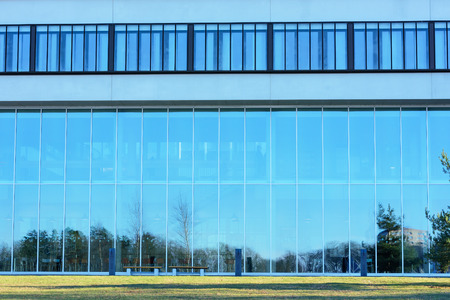institute of technology: Karlskrona, Sweden - January 13, 2016: The glass facade of Blekinge Institute of Technology (BTH) as seen from the west. The sky is reflecting in the windows. 6600 student registered in 2015. Editorial