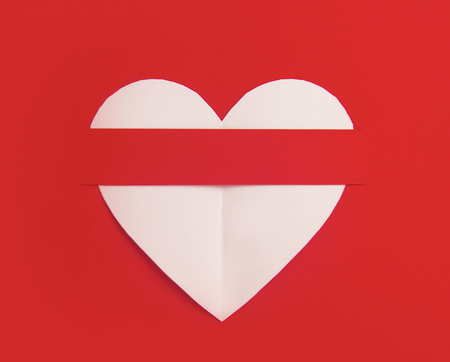 Heart shaped white paper in red background, Heart cut from white paper background, Valentines Day background, Holiday Card,