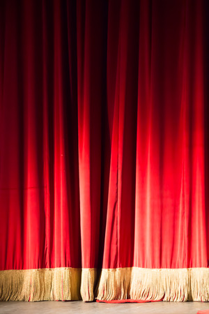 recite: red curtain in a theater