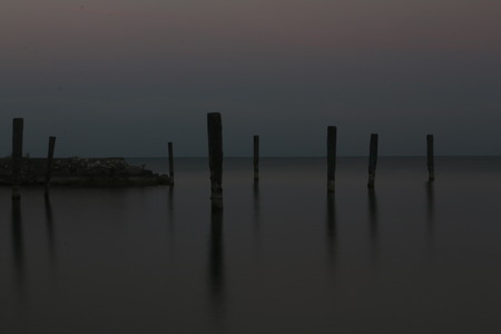 and the stakes: long exposure of Lake Garda Stock Photo
