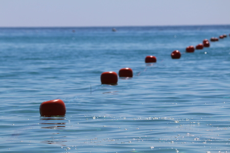 row of buoys in the sea