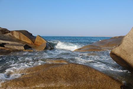 waves crashing: cliff with the waves crashing