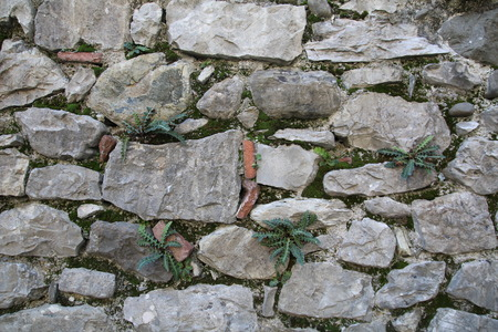 overbuilding: stone wall outdoor