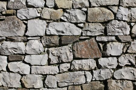 texture of a wall of irregular stones