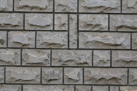 texture of a wall of rectangular tiles