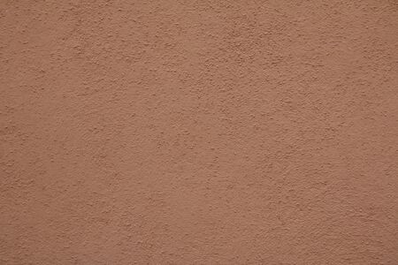 texture of a brick-colored concrete wall