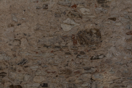 stratification: texture of wall with cracks and stones