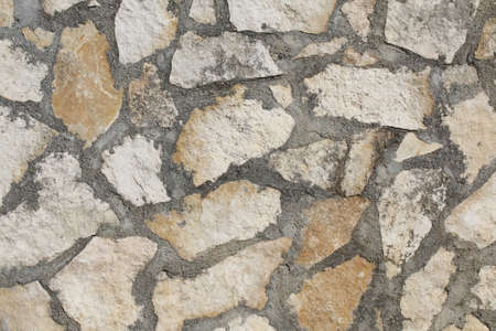 texture of a wall of stones and stones Фото со стока