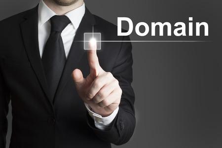 man in black suite pressing virutal button domain photo