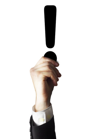 businessman holding black exclamation point in the air isolated photo