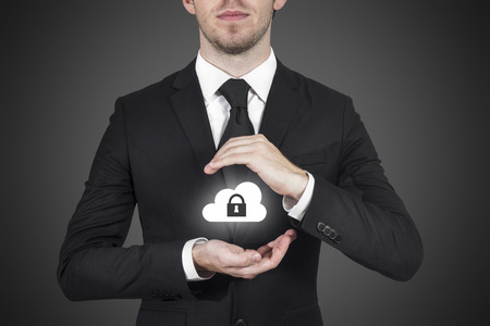 whistleblower: businessman protect cloud lock symbol with hands
