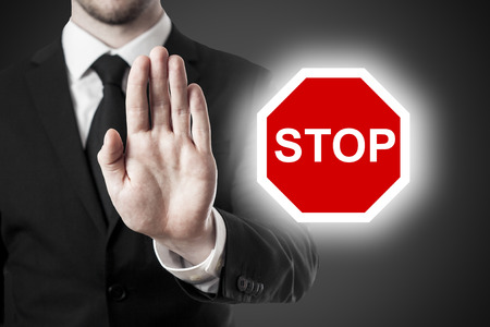 businessman holding hand block stop sign Stock Photo