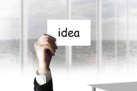 businessman hand holding white businesscard in the air idea photo