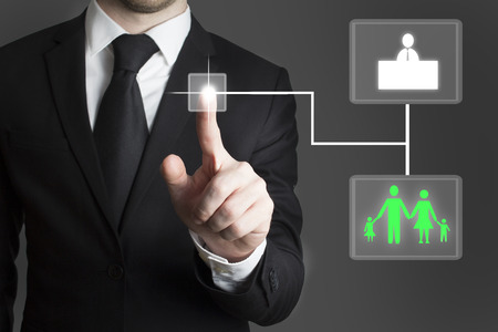 businessman pressing touchscreen button decision between family and career work photo