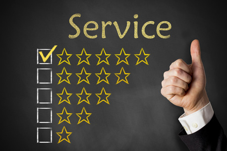 up service: thumbs up service golden rating stars on chalkboard Stock Photo