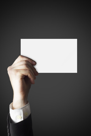 businesscard: businessman hand holding empty white businesscard in the air