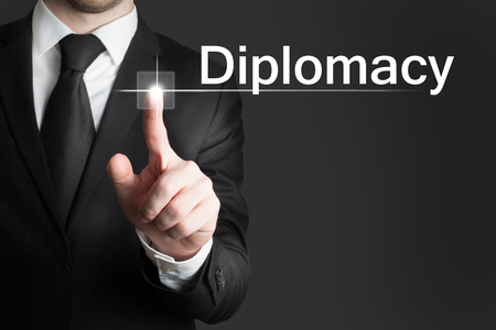 businessman pressing touchscreen button diplomacy photo