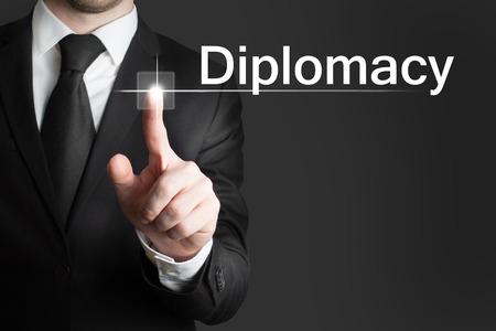 transnational: businessman pressing touchscreen button diplomacy