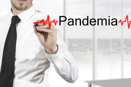 doctor in bright Hospital environment writing pandemia in the air Standard-Bild