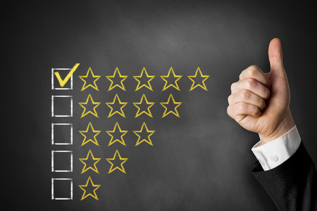 thumbs up golden rating stars checkbox on chalkboard Banque d'images