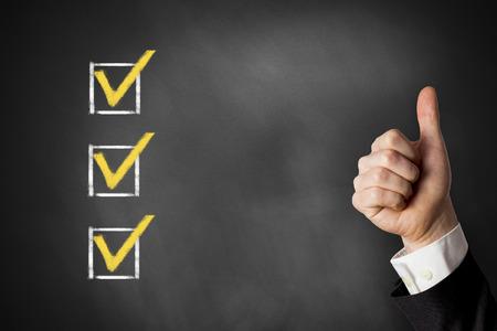 thumbs up advertisement checkbox list on chalkboard