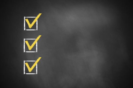 three marked checkboxes on a black chalkboard