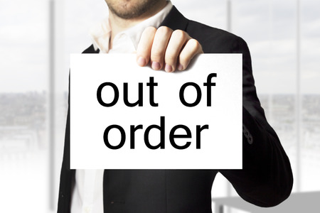 businessman holding white sign out of order burnout photo