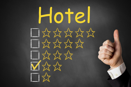 hotel reviews: thumbs up hotel golden star rating chalkboard